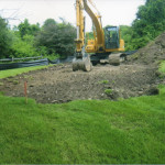 Installation of new septic system: Removed organic top soil is stored on site and crushed stone is imported to be used as a leveling system to assure system follows the lay of the land remaining below the surface and out of site. (Picture 2 of 2)
