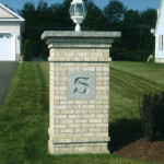 Designed and installed landscape feature incorporating this brick pier entry. Custom designed and built by Sinopoli Contractors, this pier showcases the engraved stone with family initial. (Extensive engraving options are available including house numbers and multiple initials.) Electrical wiring was contracted through Sinopoli Contractors also. (Picture 3 of 3)