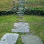 Natural fieldstone slabs were incorporated into this landscape design to compensate for elevation changes and to make it easier to walk along the path.