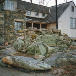 Sinopoli Contractors will hand select stone native to your setting and resituate them to create a complementary stone decorative structure in your lawn. In this photo, the stones selected had native moss on them and the moss was undisturbed to give the appearance that the stones had aged in place.