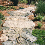 This path from the home to the pool house was created from native fieldstone and was designed and built to follow the natural contours of the land.
