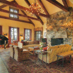 The double height fieldstone fireplace catches your breath as you enter the great room of this home.