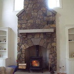 Custom built home includes a fieldstone fireplace with granite firebox and mantel.