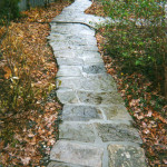 This garden path is created from granite and is set on stone dust with hand poured joints for stability.