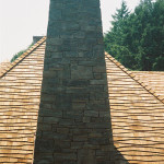 This fieldstone chimney complements the exterior fieldstone walls of home.