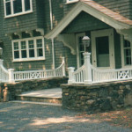 This entrance was renovated to enhance the appearance of the home. The design matched the time period of the original construction of the home and the materials were selected to look weathered and aged to match the original home construction.