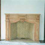 This fireplace mantel was restored from a castle in France. The firebox was built to the specification of the original French fireplace for a custom fit with the mantel.