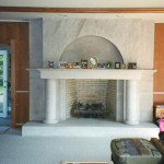 This fireplace mantel and facing is constructed of Indiana limestone with a firebrick interior.