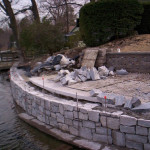 This lakeside wall is constructed from the water side while water levels are low.masonry33