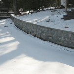 The completed lakeside retaining wall offers both aesthetics and function.