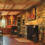 The wall-sized kitchen fieldstone fireplace warms the entire room, with or without a fire in it. Terra cotta tile flooring from a castle in France is installed in this home over a heated floor for added warmth.