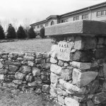 The natural fieldstone of the building was incorporated into the stone fence and entrance piers built to accent the building's natural appearance.